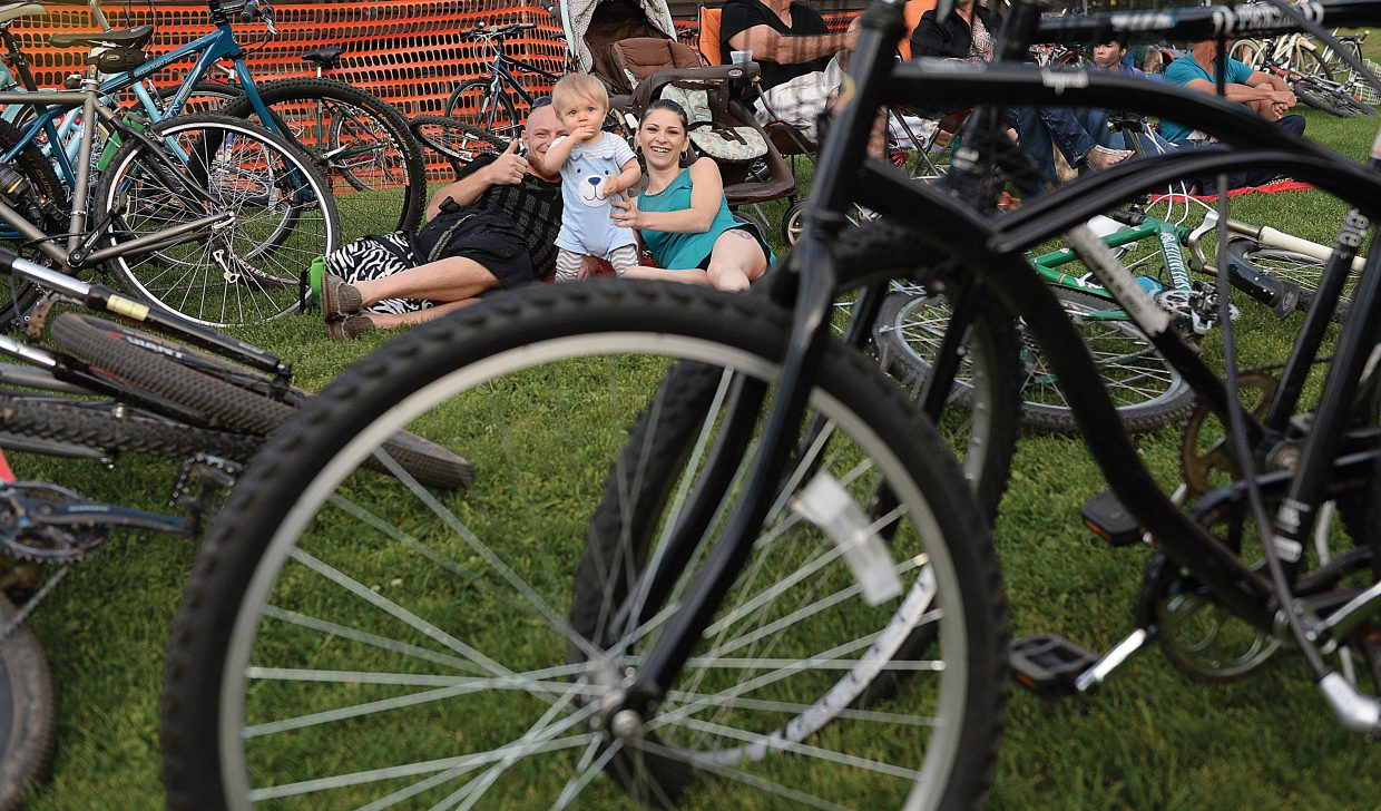 Josh (left) , Cole and Steph Starbird found a seat for the Ziggy Marley concert away from the crowded outruns of the ski jumps. They just had to find a place among the hundreds of bikes that were parked at the base of Howelsen Hill for the concert.