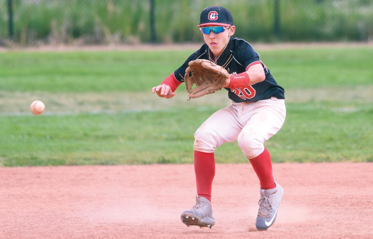 Patrick McLelland, of the San Diego-based California Lookouts, fields a ground ball during a game against the Kerrville Indians in Triple Crown World Series action Friday at Howelsen Hill. The Triple Crown World Series draws teams from around the country to compete for titles in Steamboat Springs.