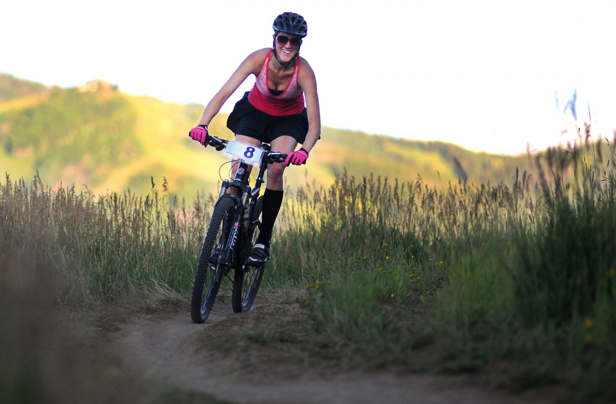 Gretchen Coleman rides Wednesday in the Town Challenge mountain bike race on Emerald Mountain.