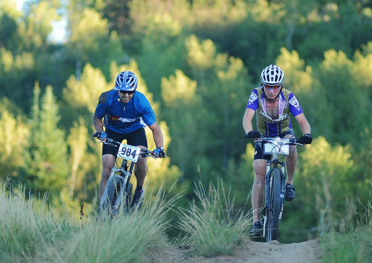 Bryan Dugan, left, and Steve Colby ride Wednesday in the Town Challenge mountain bike race on Emerald Mountain.