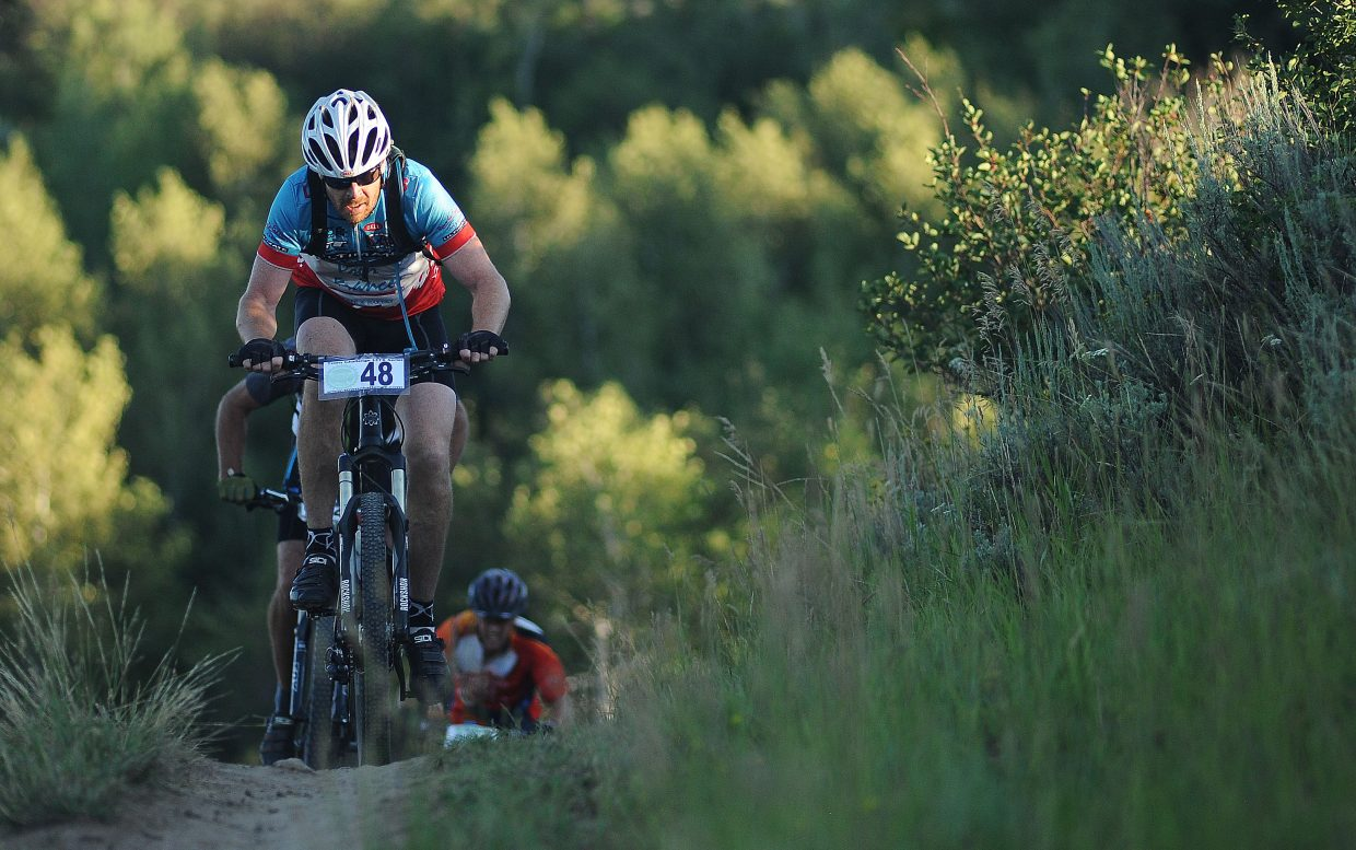 Chris Mitchell rides Wednesday in the Town Challenge mountain bike race on Emerald Mountain.