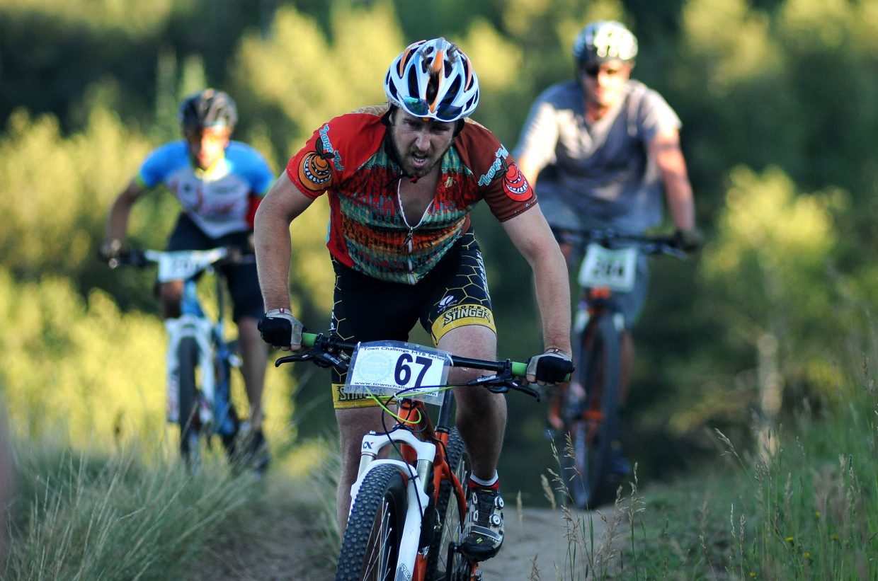 Matt Eggen tries to stay in front of a crowd during Wednesday's Town Challenge mountain bike race on Emerald Mountain.