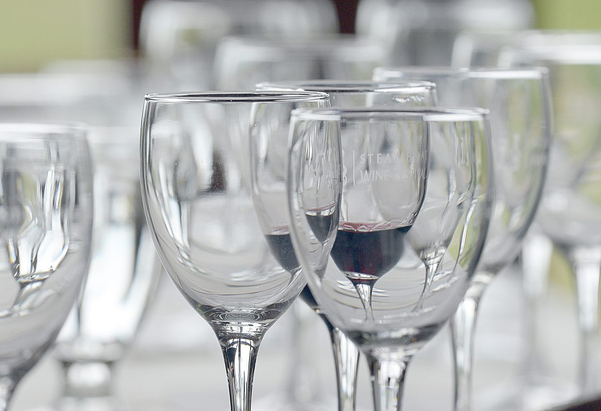 """Wine glasses were lined up on the tables Thursday afternoon for the """"Wine and Nine """" event at the Haymaker golf course. The event was part of the Steamboat Wine Festival, which runs Aug.5 through 9."""