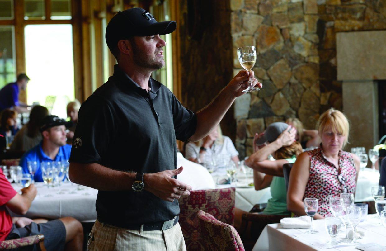 """Grant Jennings, US Director of Sales for Loscano Wines, describes one of his companies wines during the """"Wine and Nine"""" event at the Haymaker Golf course Thursday afternoon. The event was part of the Steamboat Wine Festival, which runs through Sunday."""