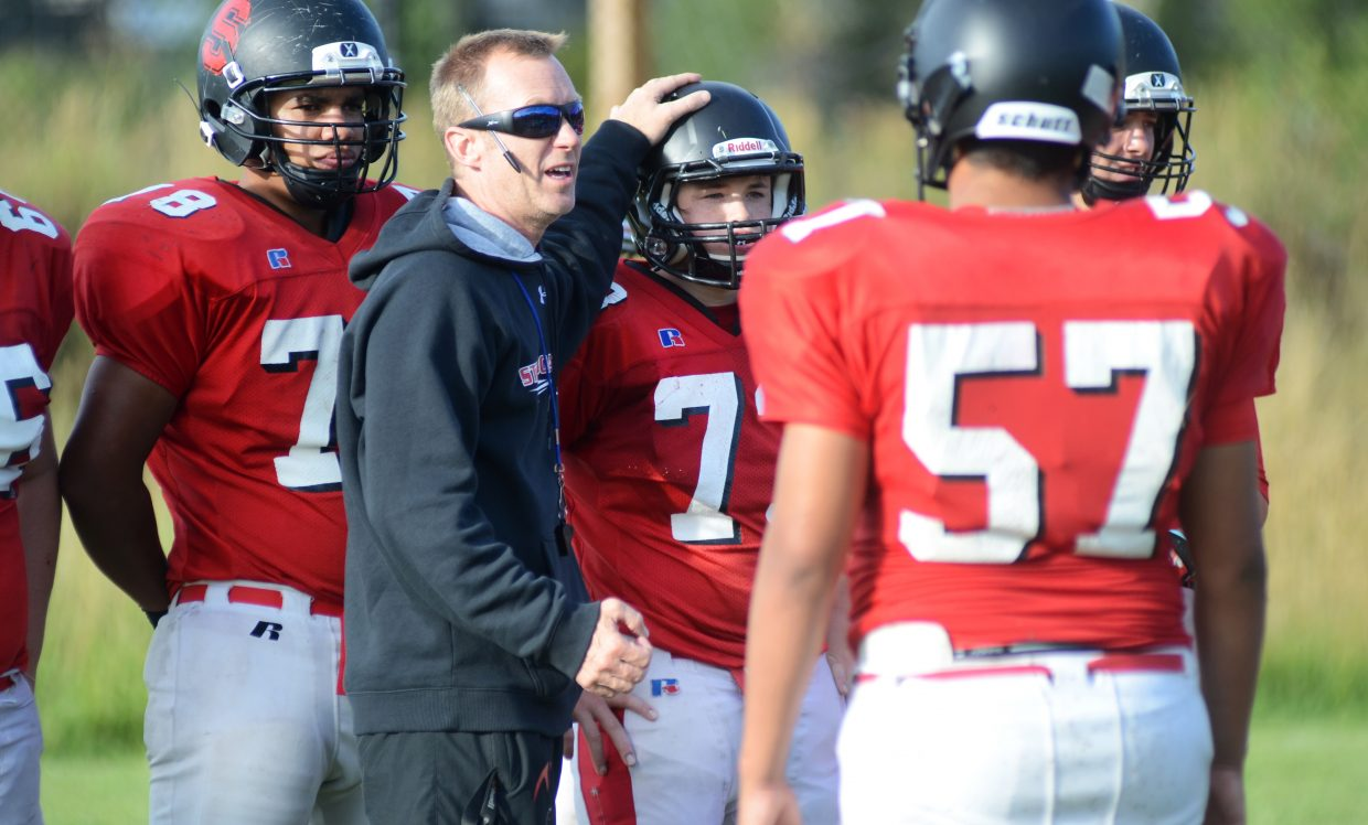 Lonn Clementson works with his team last fall. The Steamboat Springs High School football coach said he's eager for this season and optimistic about his team.