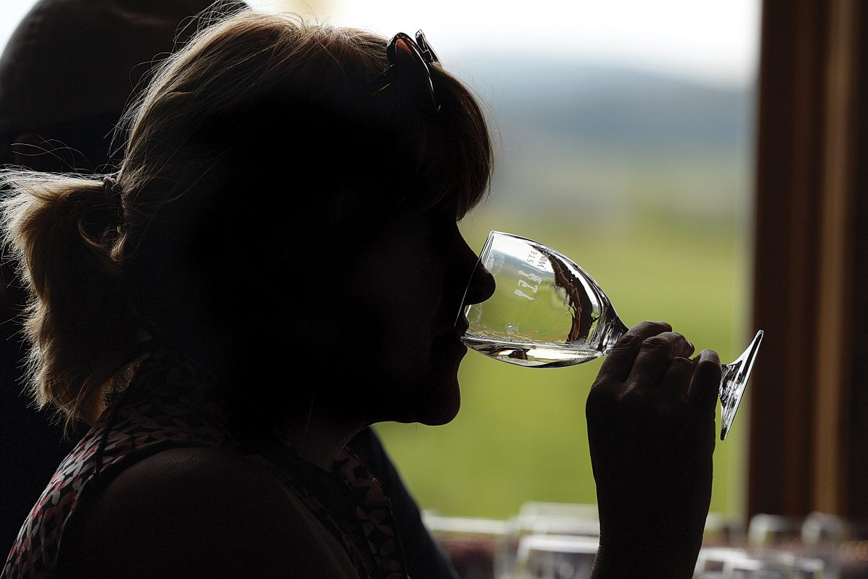 """Susan Paulson, of Denver, tastes the wine during the """"Nine and Wine"""" event at the Haymaker Golf Course. Participants played nine holes of golf and then were treated to a wine tasting following the game. The event was part of the Steamboat Wine Festival, which runs Aug.5 to 9."""
