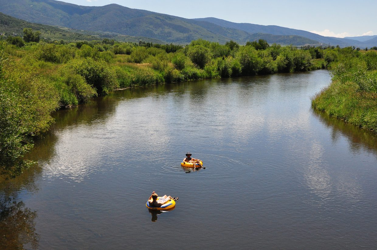 Joel and Andrew Parliment enjoy tubing Thursday afternoon while they have most of the river to themselves. The river is flowing slightly above its historic average for this time of year.