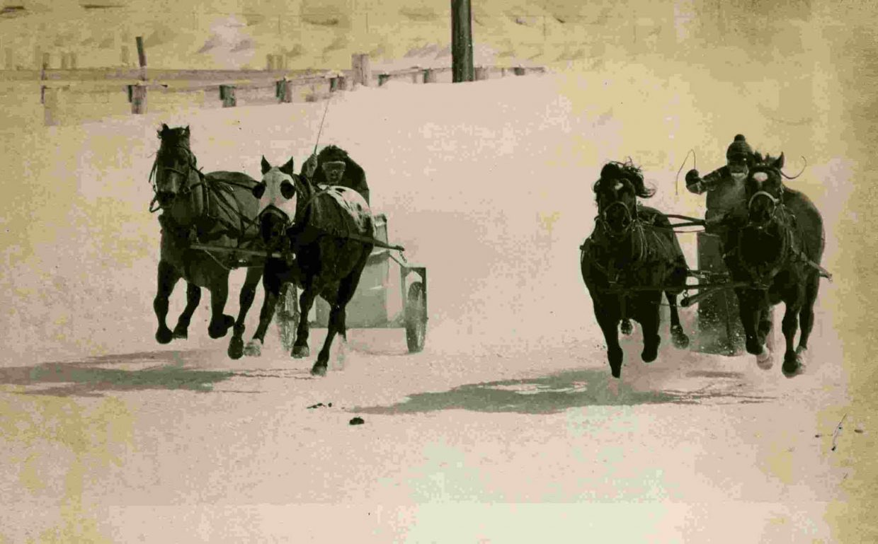 A pair of chariot racers dash down the track at the Howelsen Hill Rodeo Arena in Steamboat Springs in days gone by.