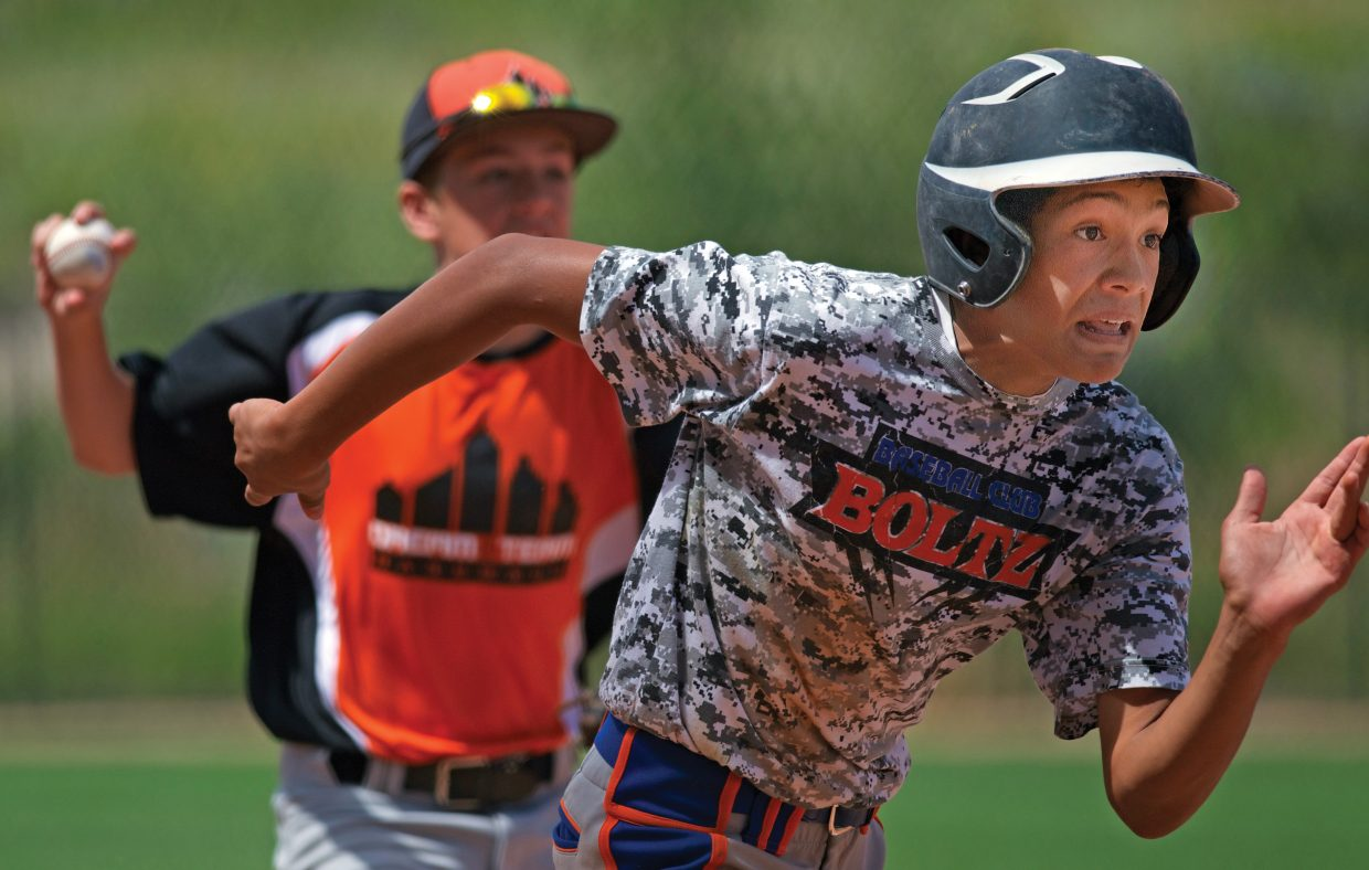 Jayden Kay, of the Boltz from Billings, Montana, heads for home after getting caught in a run-down during a Triple Crown game Friday morning. The Boltz beat the Dream Team, from Washington in a hard-fought 11-7 game.