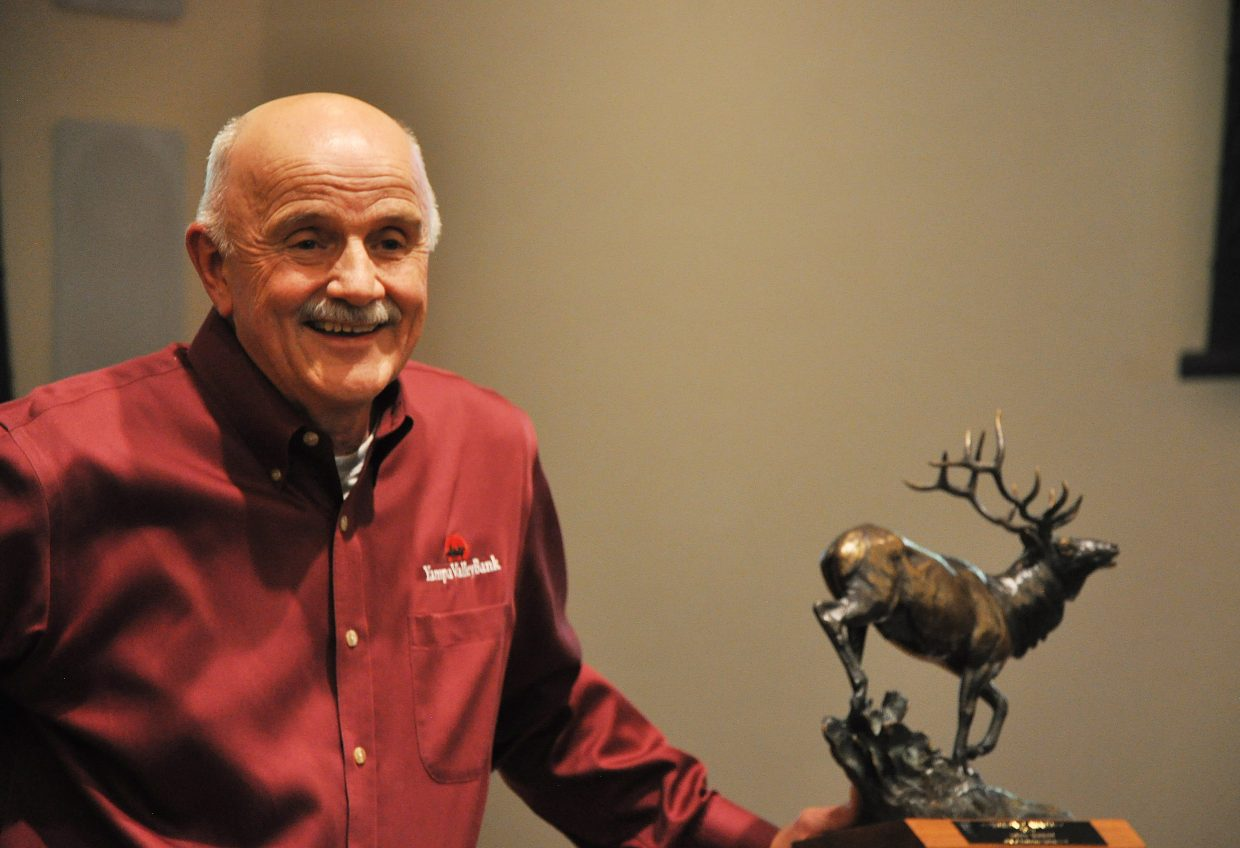 Local banker and philanthropist John Kerst accepts Steamboat's coveted Heritage Award on Thursday night. The award was presented to Kerst for 26 years of service here in Steamboat. At an award ceremony in Citizen's Hall, Kerst was showered with praise by his friends and colleagues. The award itself is a six-point bronze elk statue designed by local rancher and sculptor Curtis Zabel. It is awarded every two years.