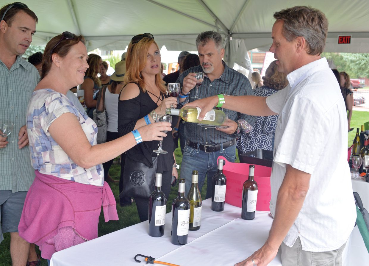 Kelly Lansford gets a sample from wine vendor Bill Petersen at this year's Steamboat Wine Festival's Stroll of Steamboat, which took place Friday evening in downtown Steamboat Springs. The Wine Festival will continue Saturday with a number of events, ranging from Hike & Hops at the Four Points Lodge to the Beer-B-Q on Saturday evening at Torian Plum Plaza.