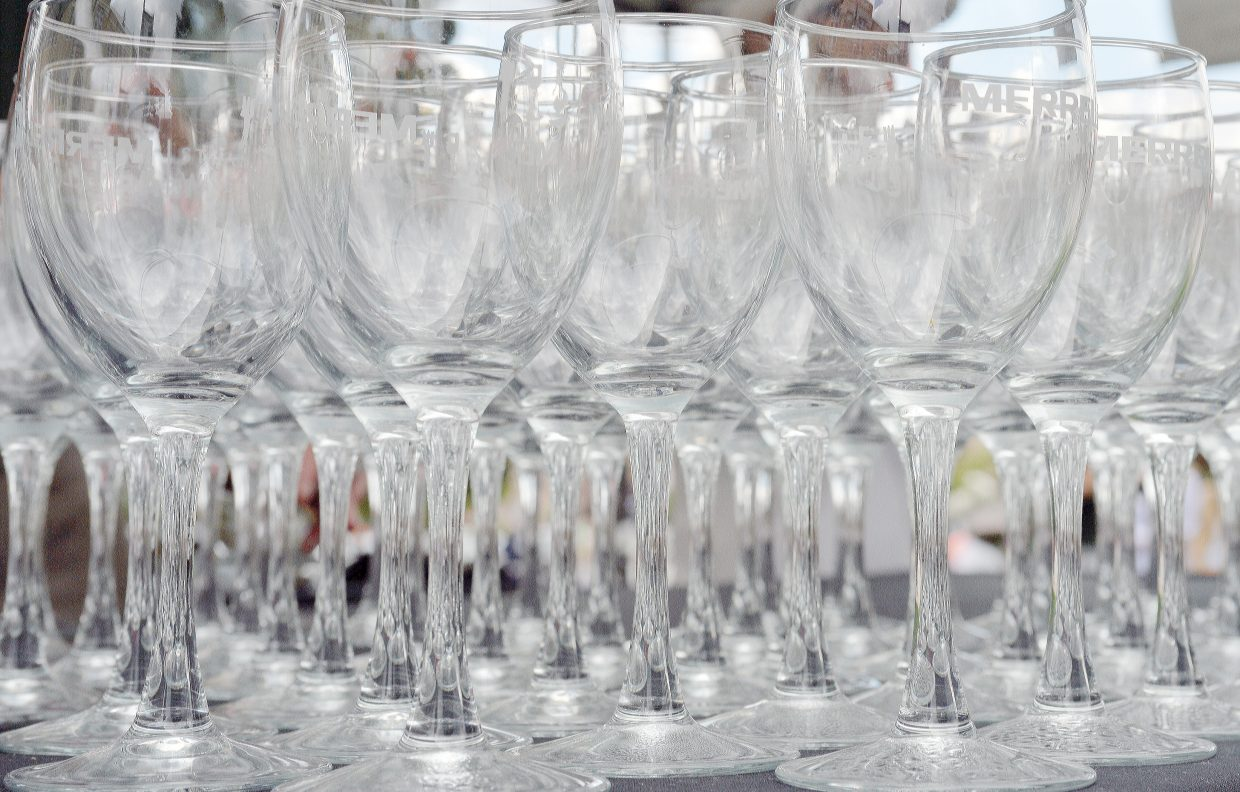 Wine glasses are lined up on a table on the courthouse lawn Friday night for the Steamboat Wine Festival's Stroll of Steamboat. The Wine Festival will continue Saturday with a number of events, ranging from Hike & Hops at the Four Points Lodge to the Beer-B-Q on Saturday evening at Torian Plum Plaza.