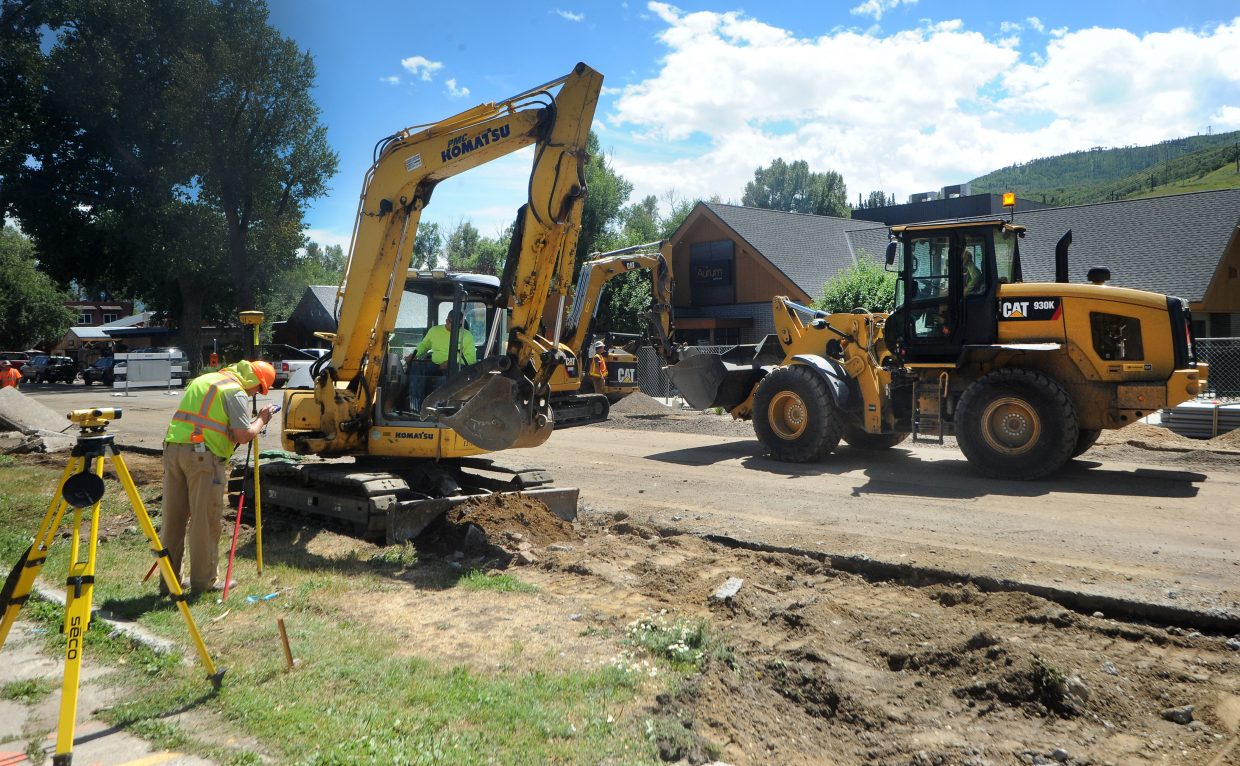 Construction crews work Monday on Yampa Street in front of Aurum Food & Wine. Businesses in the cone zone have reported varying levels of impact from the road work.