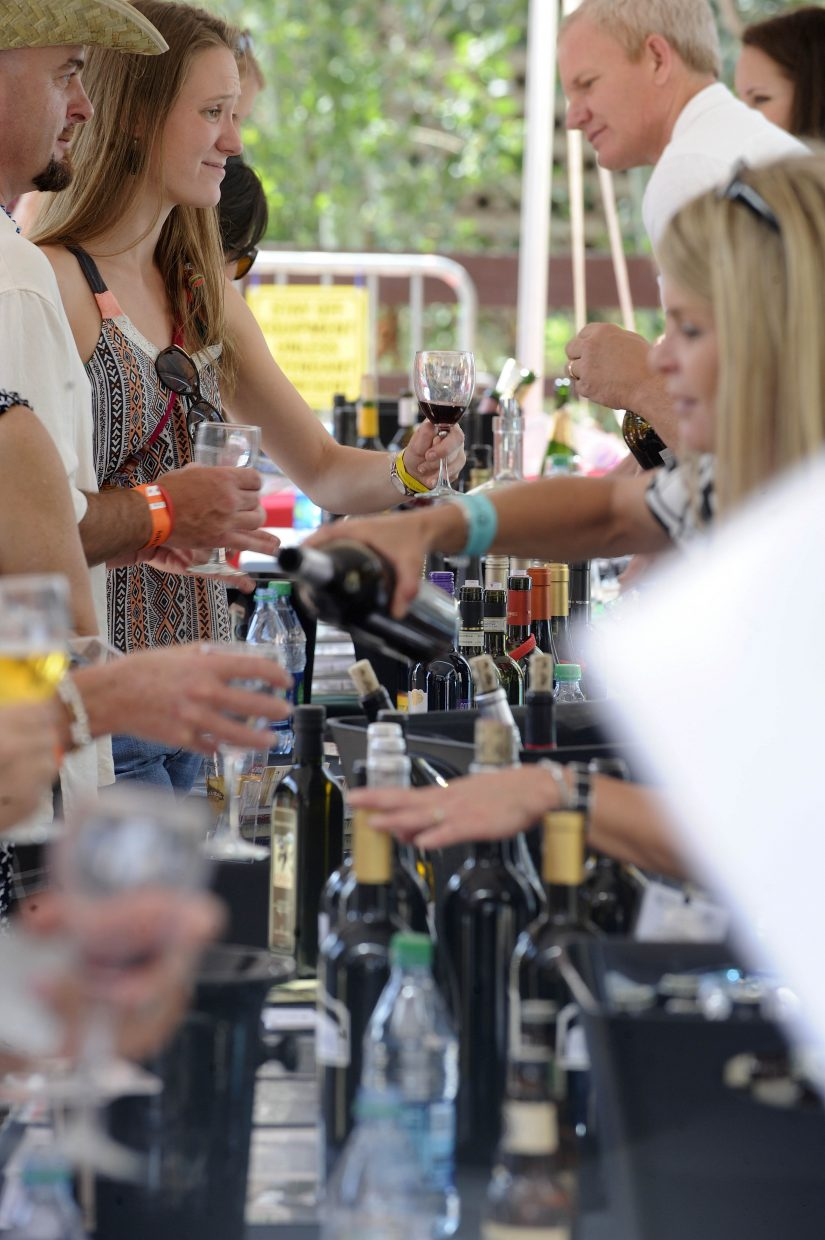 Wine is poured Saturday during the Steamboat Wine Festival Toast of Steamboat Grand Tasting event in Gondola Square.