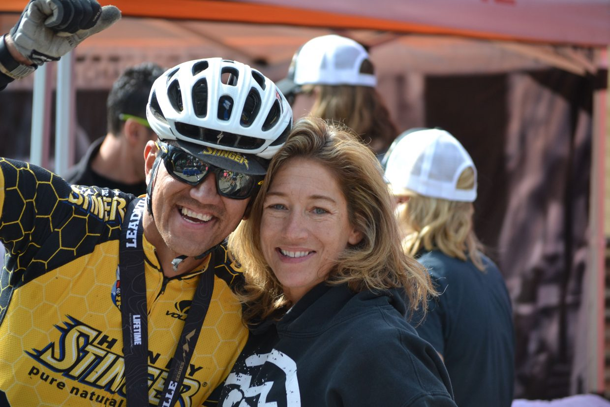 Chad James, left, celebrates with his wife, Sabrina James, after he finished the Leadville 100 mountain bike race on Saturday. Sabrina and other friends helped as a pit crew while Chad realized a goal he's been chasing for two years.