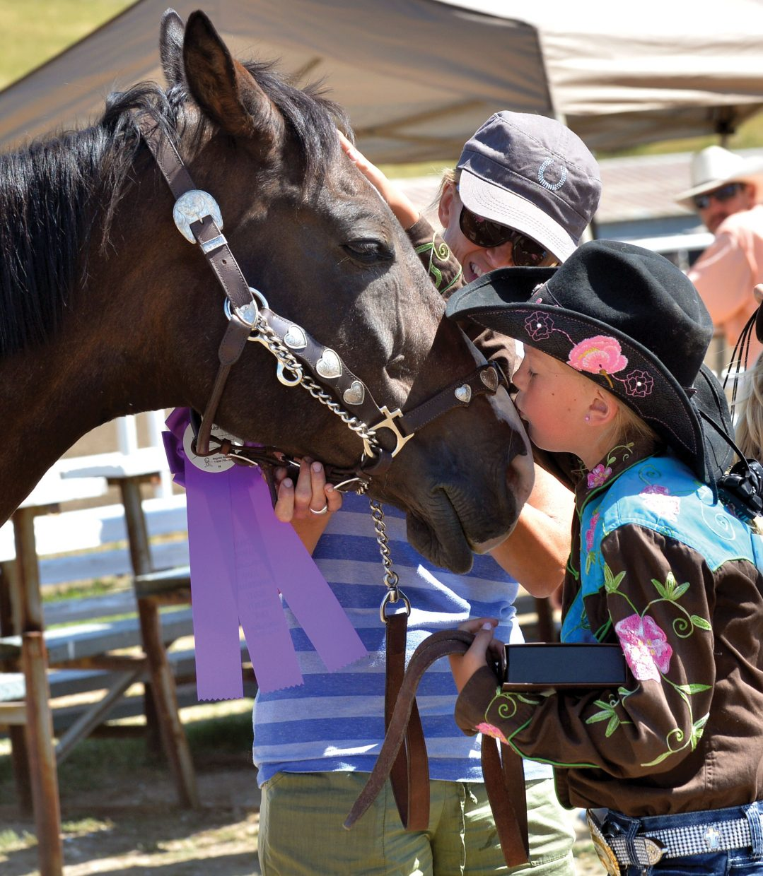 Caroline McLaughlin, 10, kisses her horse Zip after winning showmanship for the junior class at the Routt County Fair Monday in Hayden. The 4-H horse show was the first event of the week and drew more than 40 competitors to the arena to compete in halter, showmanship and riding classes.