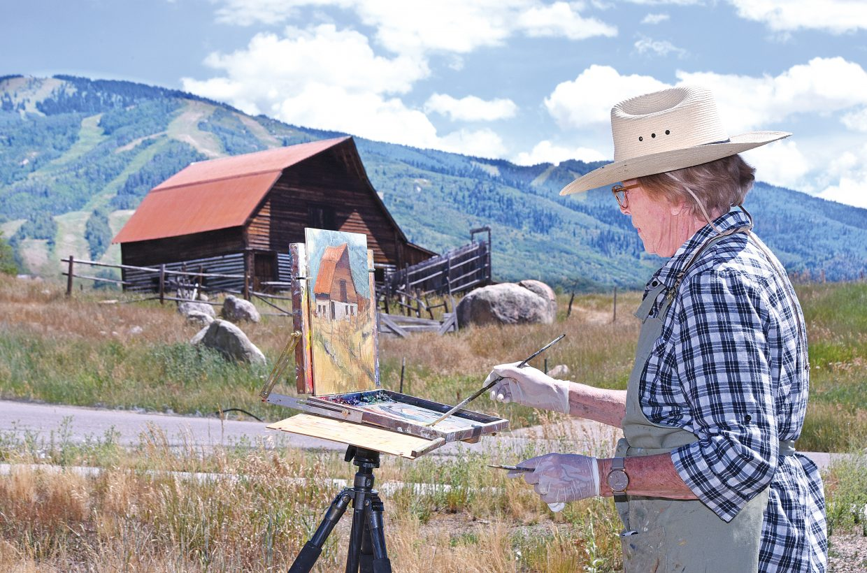 Plein Air Jean Perry works on her latest creation near the More Barn.