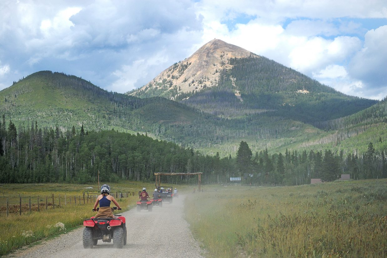 An ATV tour departs the Hahn's Peak Roadhouse Thursday afternoon on a trail system that goes around the iconic mountain in North Routt County.