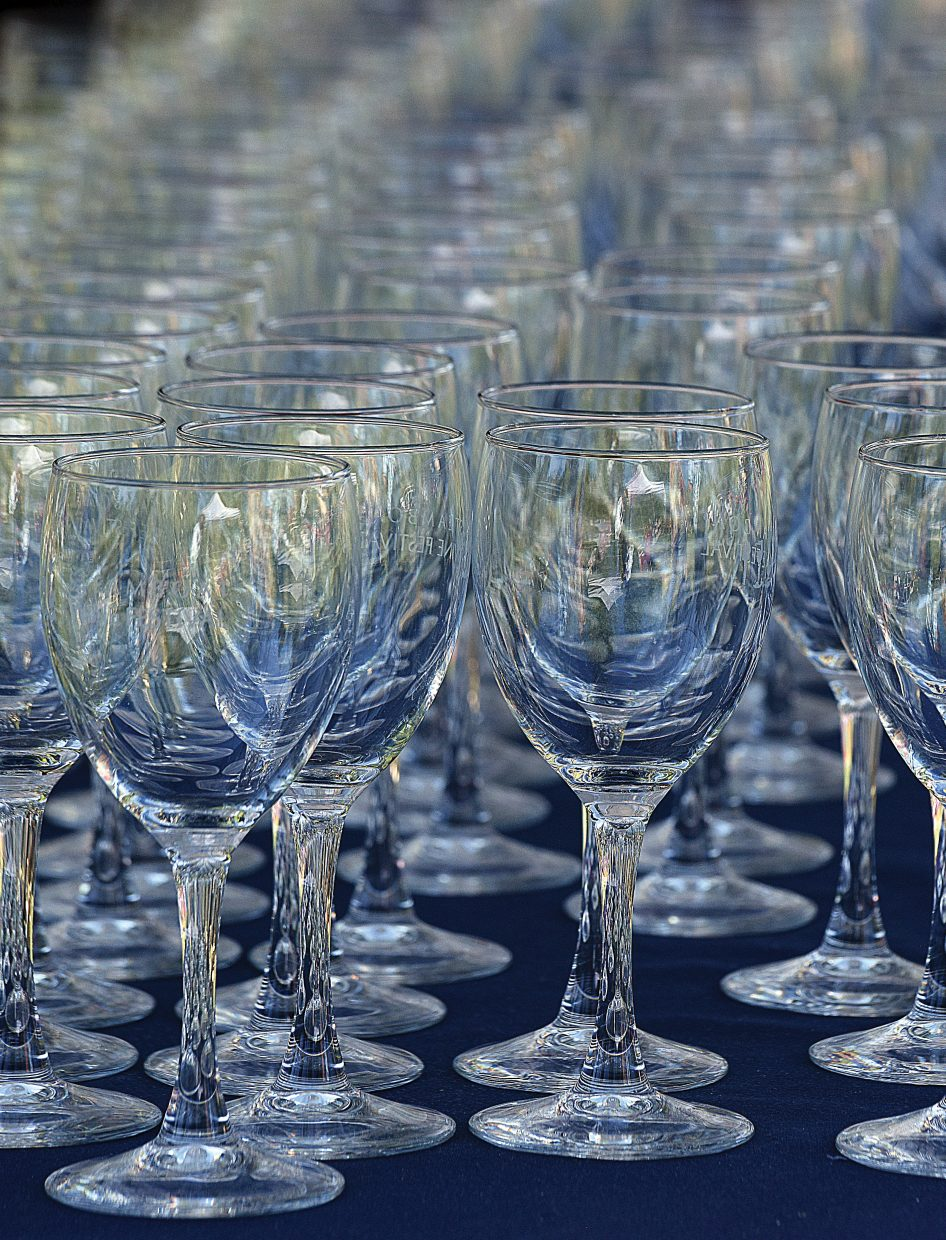 Wine glasses wait to be picked up Friday at the check-in tent for the Steamboat Wine Festival.