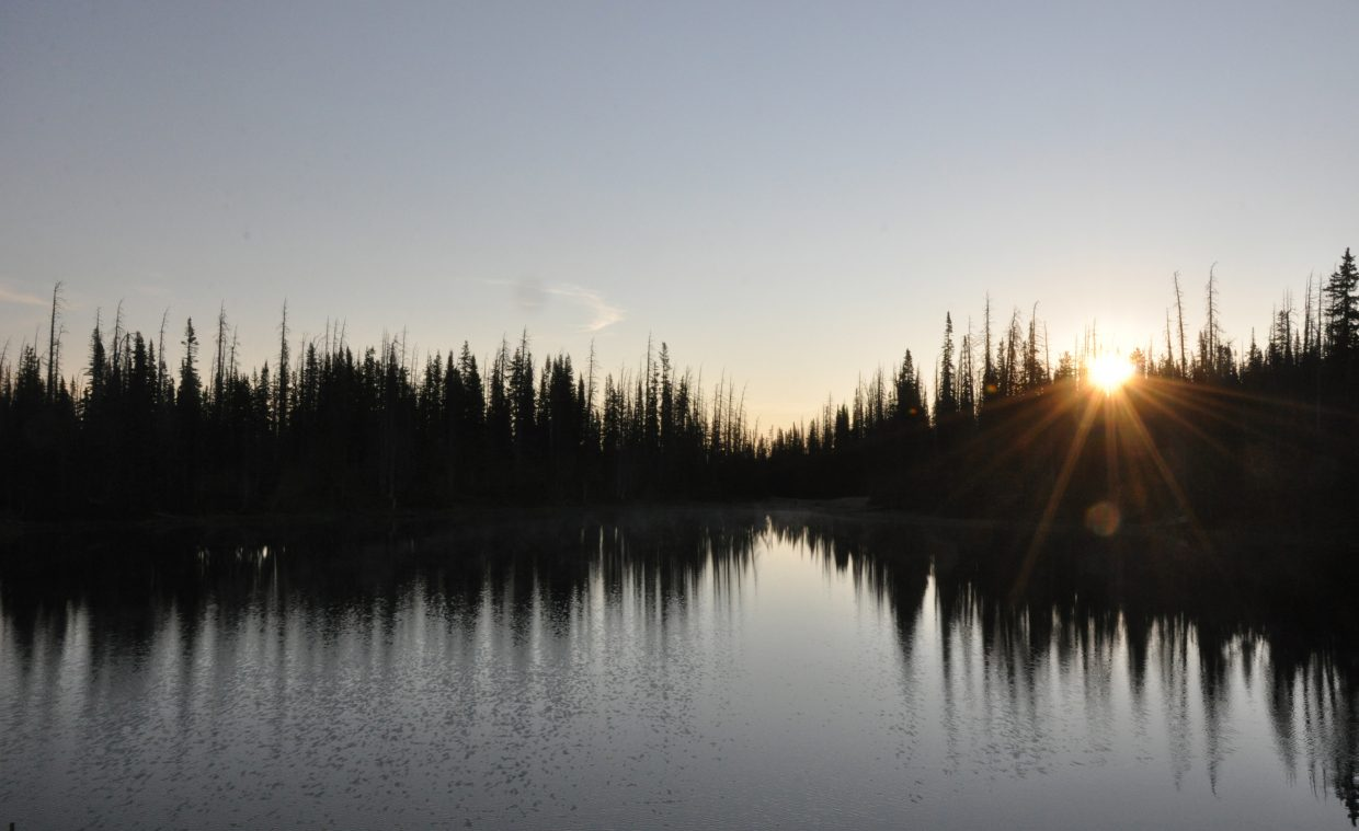 The sun rises above Summit Lake on Buffalo Pass.