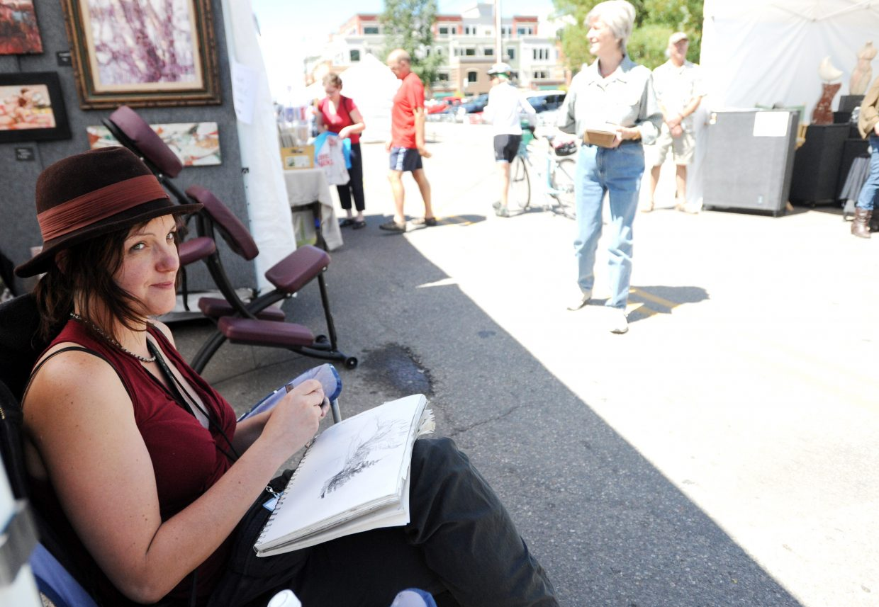 Tiffany Williams, of Denver, studies the details of a scene she was drawing during a past Yampa Art Stroll. The 2014 event will move from Yampa Street to Torian Plum Plaza at the base of Steamboat Ski Area.