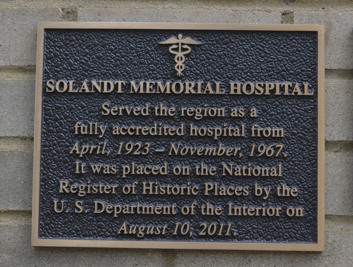 A plaque on the outside of Hayden's Solandt Memorial Hospital building acknowledges its place on the National Register of Historic Places.