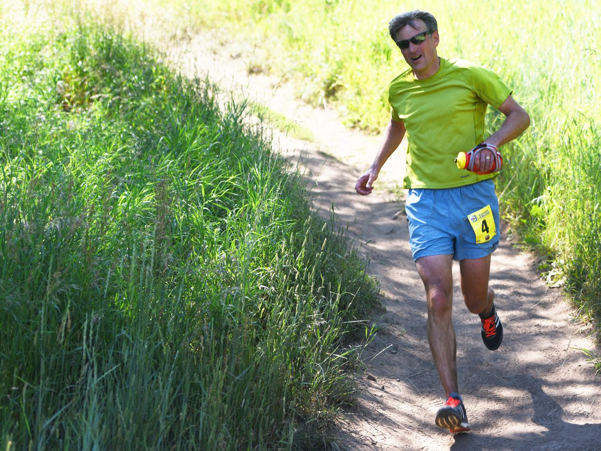 Steamboat Springs runner Allen Belshaw cruises down a hill in Sunday's Steamboat Stinger trail marathon.