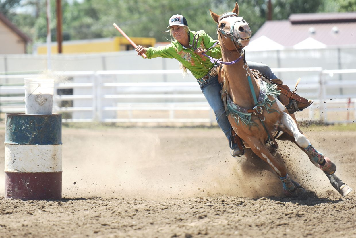 "Jewel Vreeman clings to the ""flag"" Sunday during the flag race at the Routt County Fair horse show in Hayden. The Routt County Fair got underway this weekend and will run throughout the coming week."