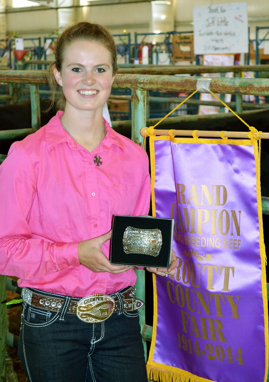 Katie Parker, 18, of Yampa, collected the belt buckle for showing the grand champion breeding cow at the 100th Routt County Fair on Friday.
