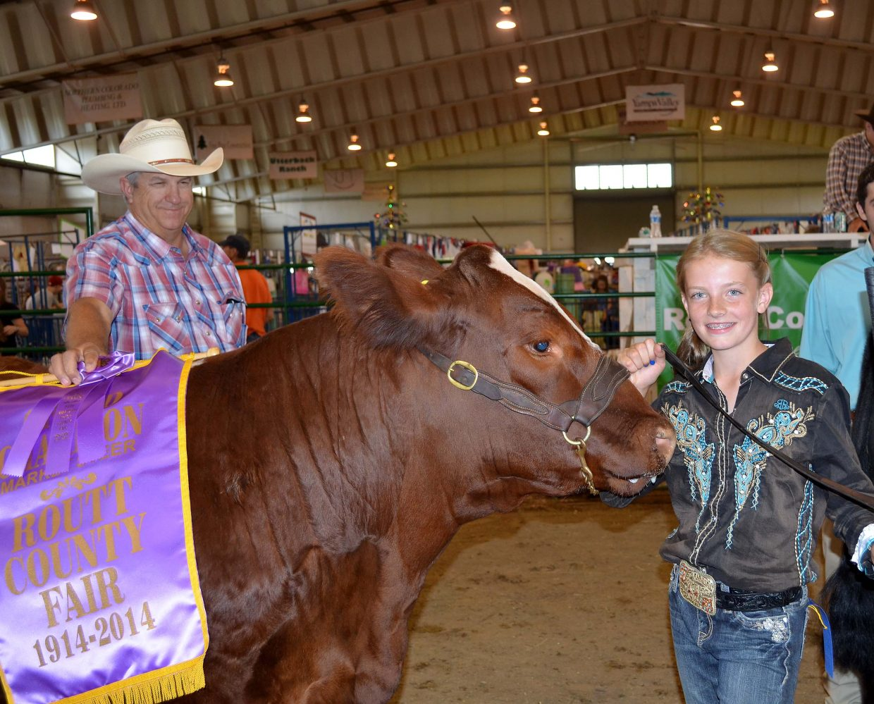 Alex Camilletti, 12, of Hayden, showed the grand champion market steer at the 100th Routt County Fair on Friday night. The steer's breed is Maine-Anjou.