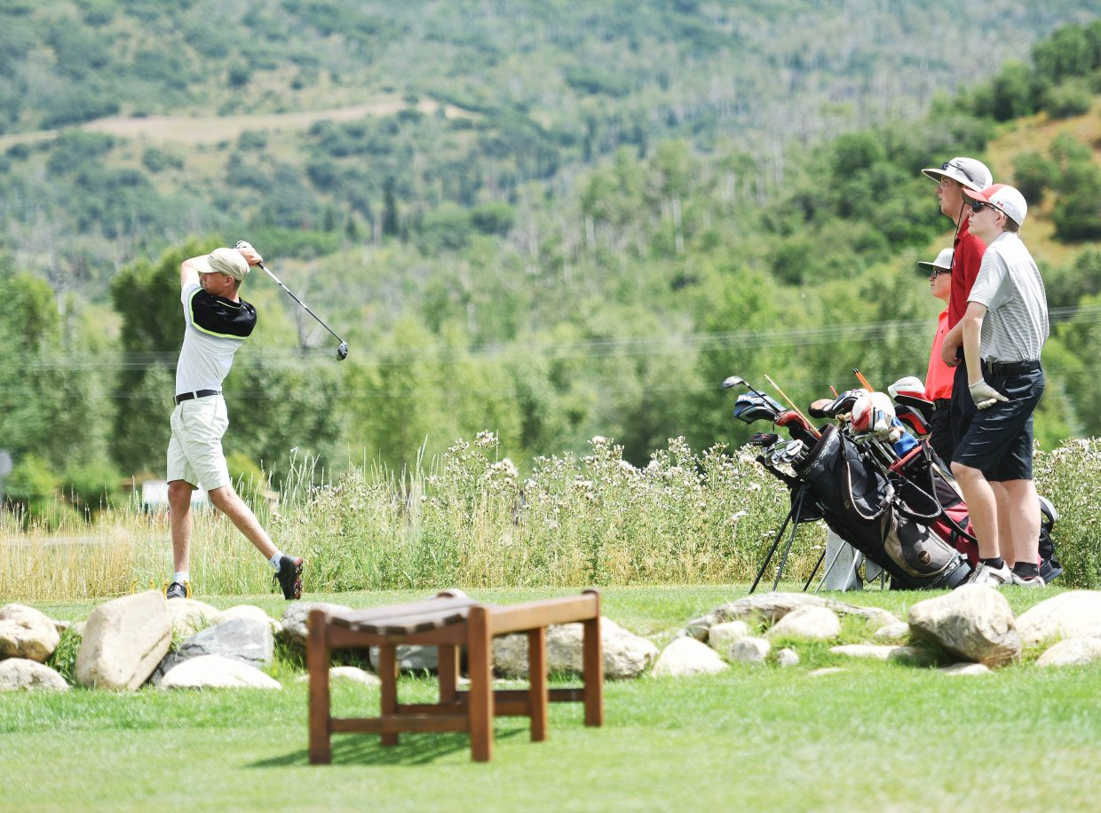 Steamboat Springs High School senior Jack McNamara, left, and a pack of Sailors watch as his drive carries down the fairway at Haymaker Golf Course during a practice last week. The high school's golf team opened its season Monday.