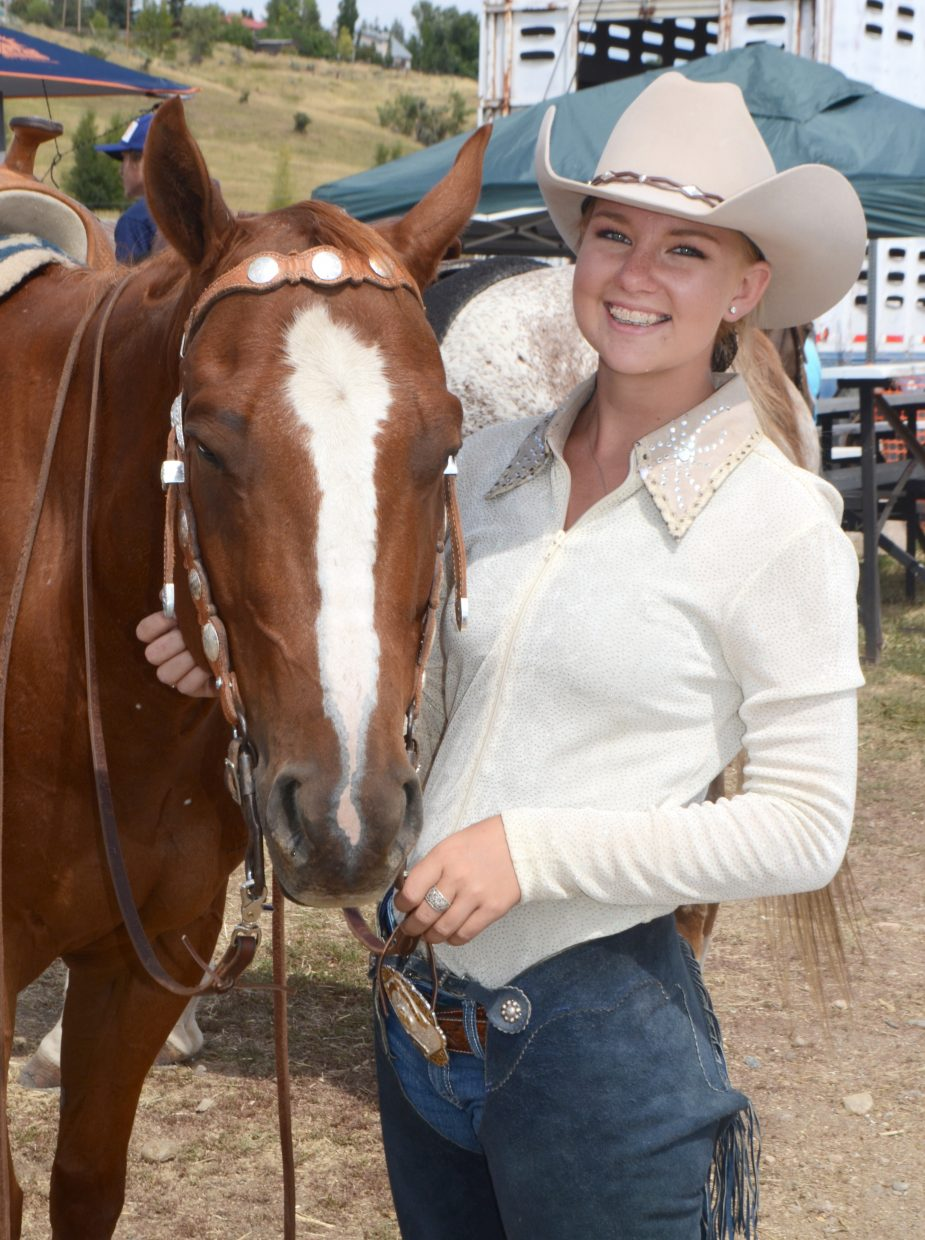 Routt County Fair Queen Karyn Forbes, 15, with her horse, Bentley, relies on multi-flavored snow cones to get her through four days of competition in the hot August sun. Forbes and Bentley picked up several blue ribbons Aug. 15.