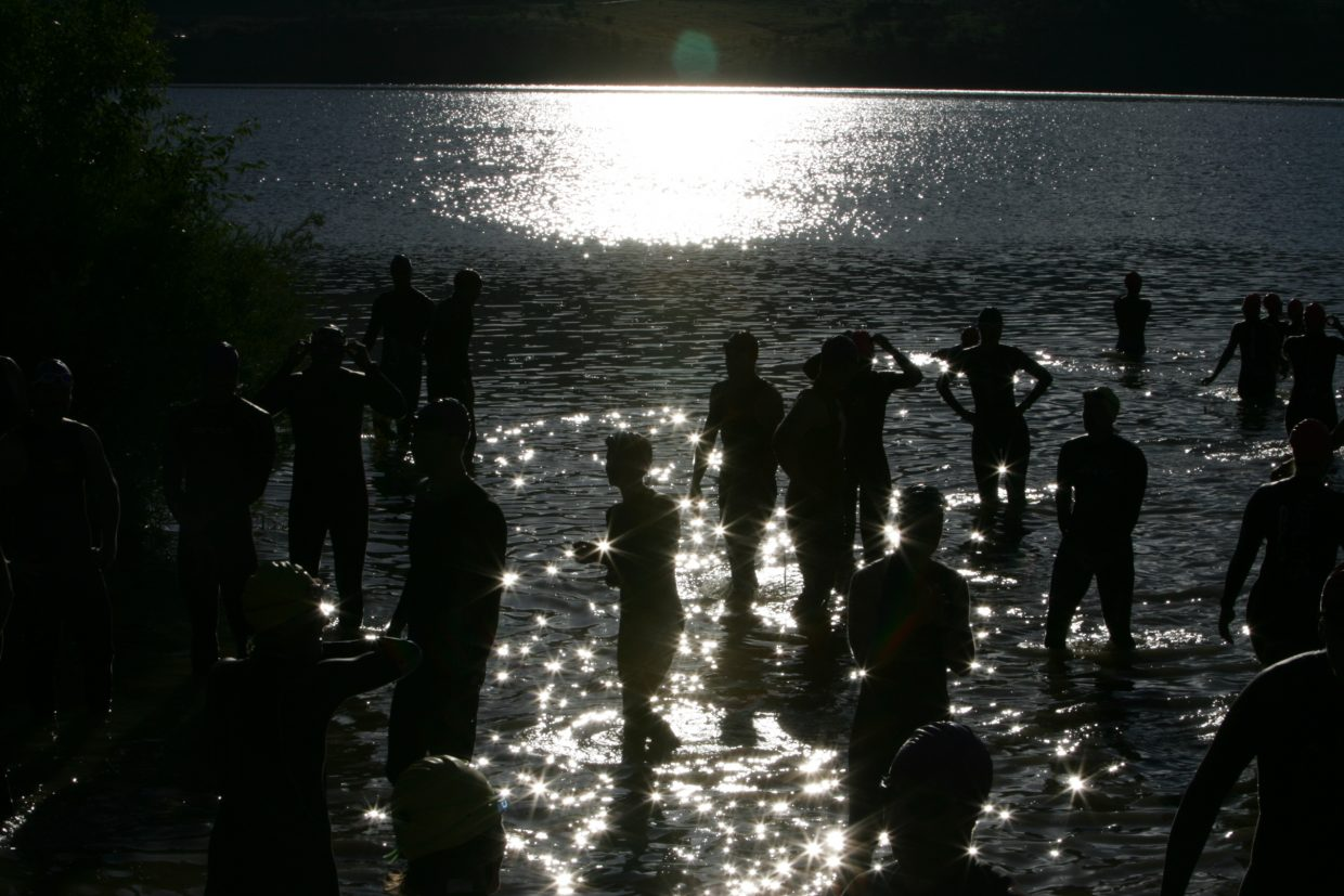 Contestants at the Steamboat Triathlon at Lake Catamount warm up prior to the start of the 10th annual race. Submitted by Peter Arnold.