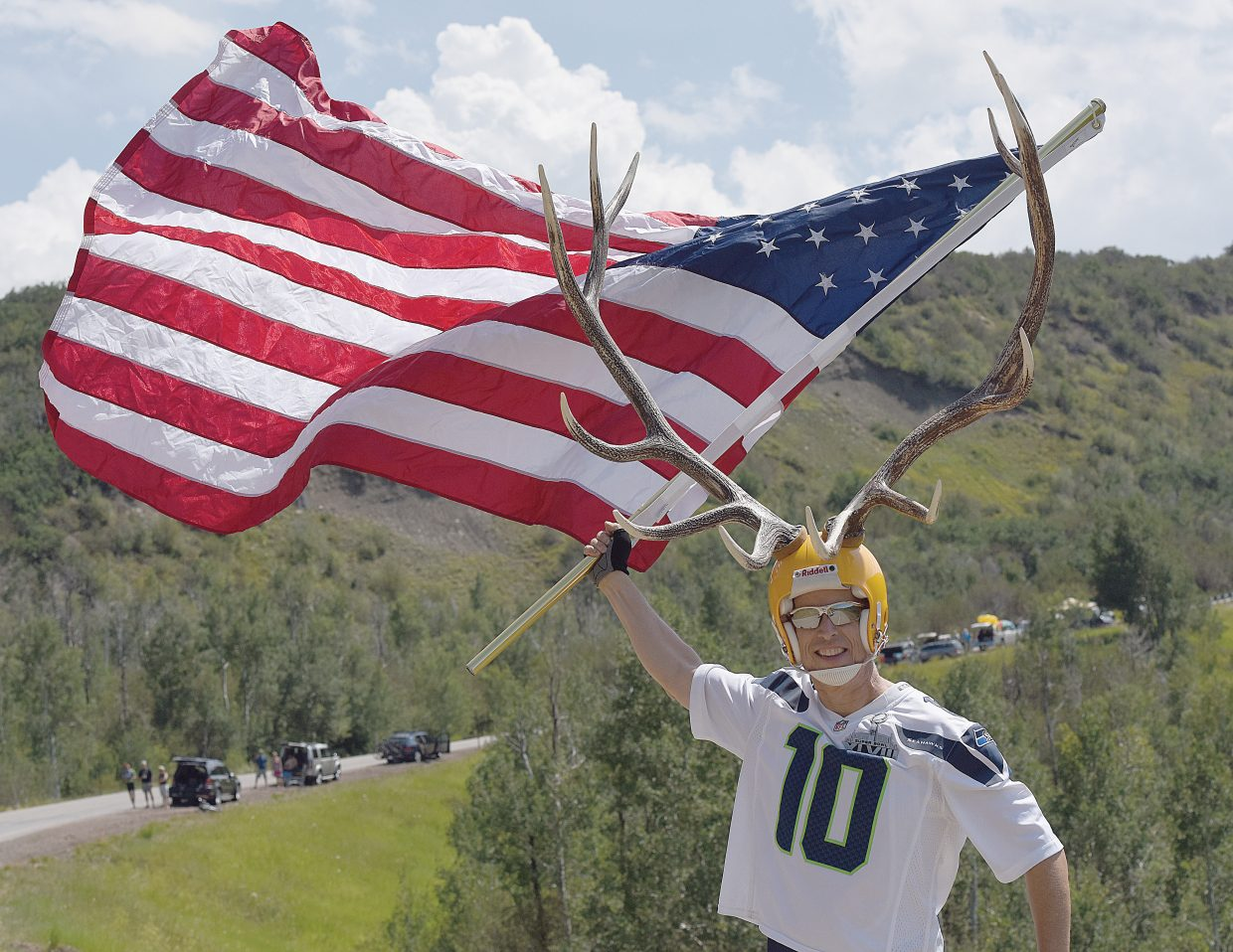 One of the more enthusiastic fans waits for approaching riders near the King of the Mountain finish on Routt County Road 27 between Steamboat Springs and Oak Creek Monday afternoon.