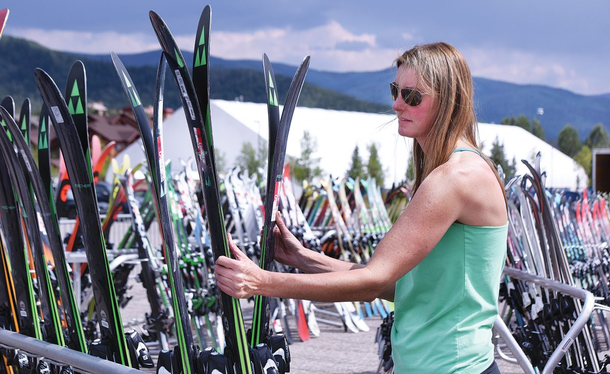 Christy Sports employee Laura Rotaru works setting up the Powder Daze Tent Sale in the Meadows Parking lot Wednesday in Steamboat Springs. The sale, which begins Friday, is an end-of-season tradition in Steamboat Springs for those looking forward to the start of the ski season in a few months.