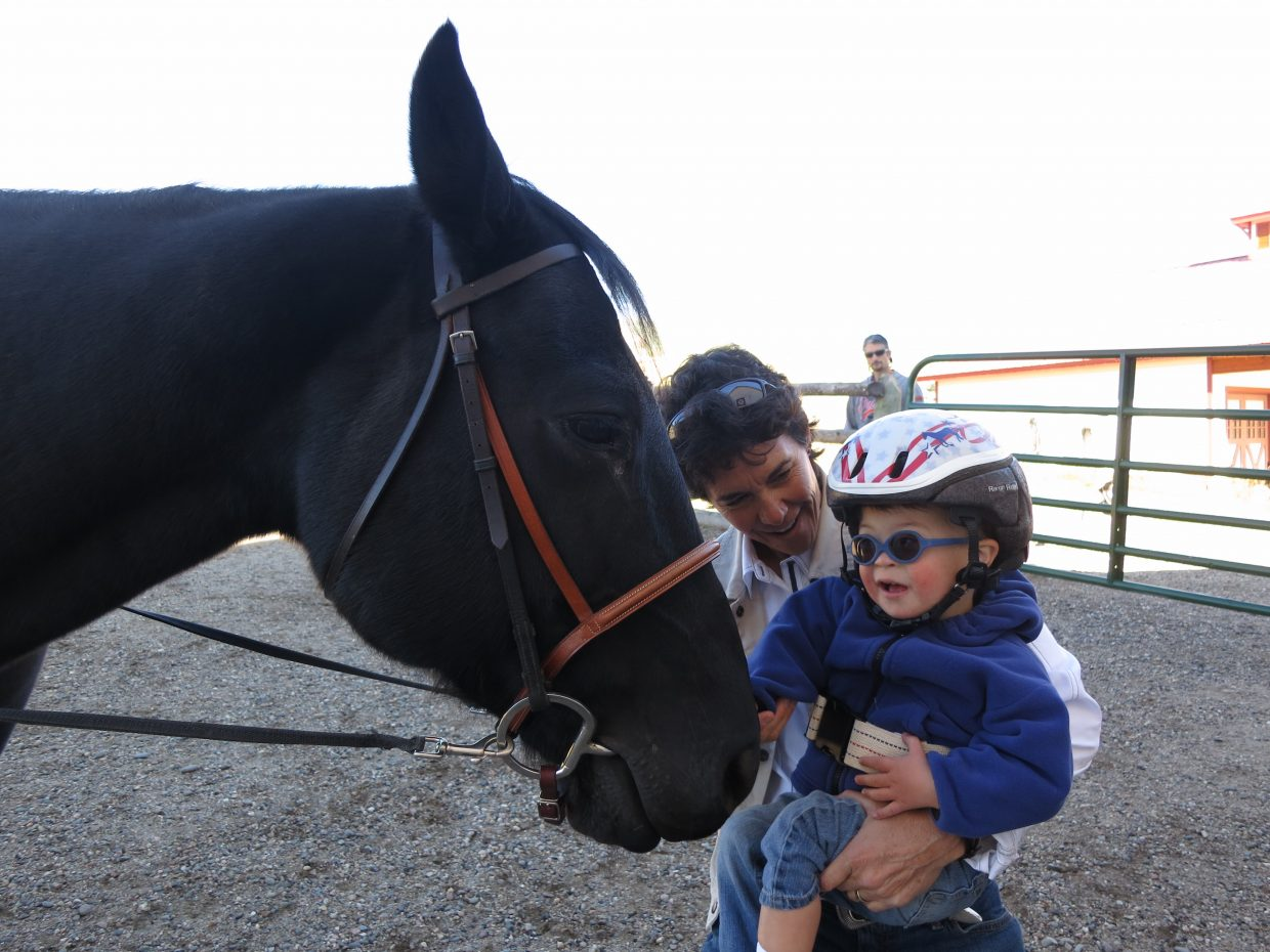 A young boy greets his horse before a therapy session with Cheri Trousil at Humble Ranch Education & Therapy Center. Most of the ranch's equine therapy activities will be run by Steamboat Adaptive Recreational Sports beginning next June.
