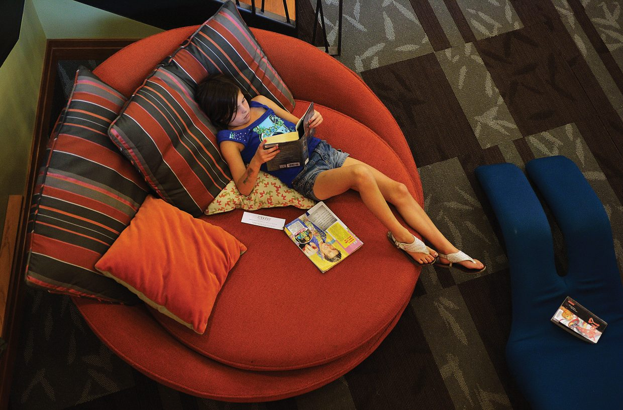 Alicia Sabin spent one of her final summer days inside the Bud Werner Memorial Library on Tuesday afternoon with a good book. Alicia, who attends Strawberry Park Elementary School, will return to classes next week.