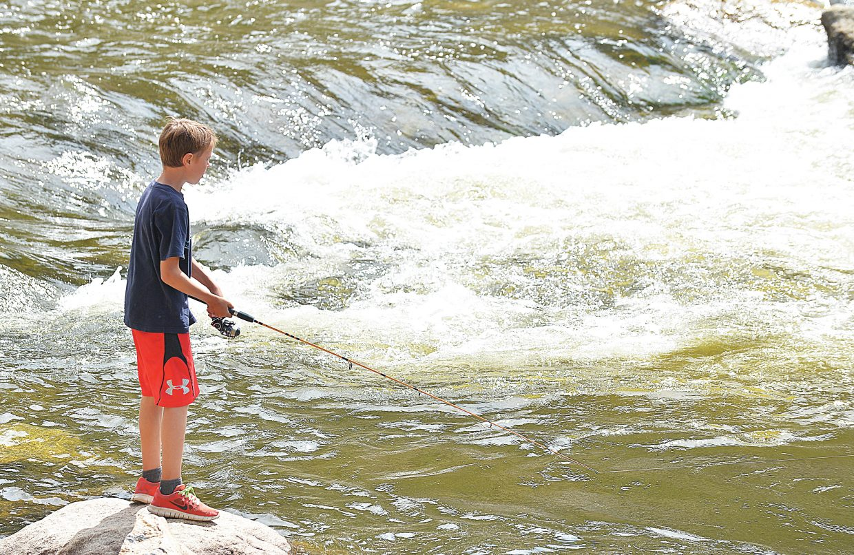 Owen Petersen tests the waters at Charlie's Hole in downtown Steamboat Springs on Tuesday afternoon. Petersen, who is a fifth-grader at Strawberry Park Elementary School, will be headed back to class next week as classes resume for the school year.