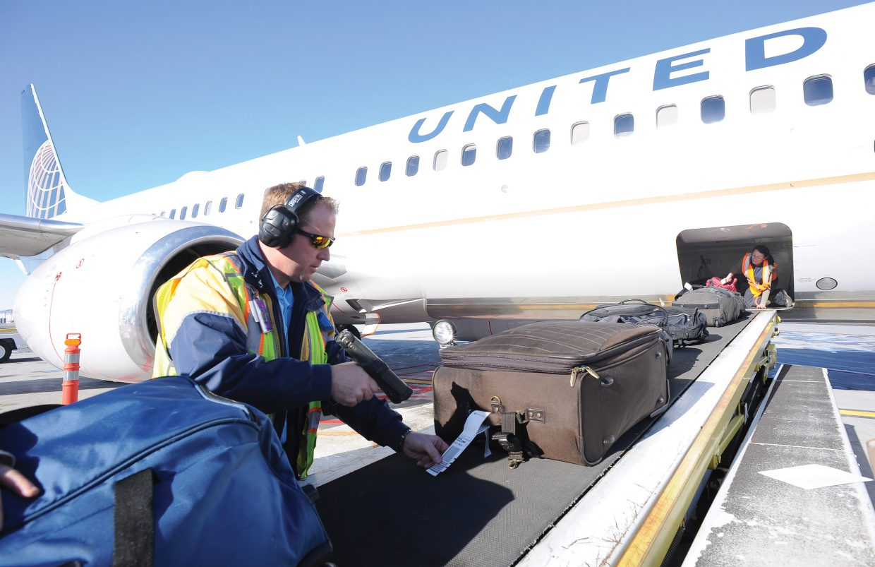 Steamboat Springs City Council is expected Sept. 6 to consider the 2017 operating plan and budget submitted by the Local Marketing District board. It represents the last budget for the foreseeable future to rely partially on a .25 percent city sales tax. Pictured: Harold Bane and Grasiela Michaels unload a United Airlines 737.