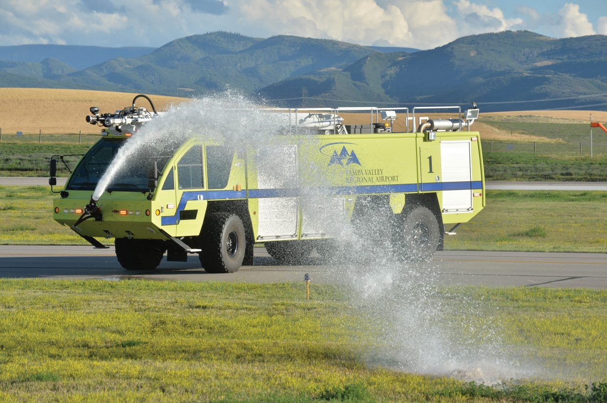 A high-end fire truck at the Yampa Valley Regional Airport takes part in Wednesday evening's mass casualty drill. The drill, which takes place once every three years, allows agencies from Oak Creek, Steamboat Springs, Hayden and Craig to run through procedures as though a commuter plane had crashed at the airport. The drill is designed to test procedures that are already in place and give agencies a chance to practice the scenario as if a disaster had taken place.