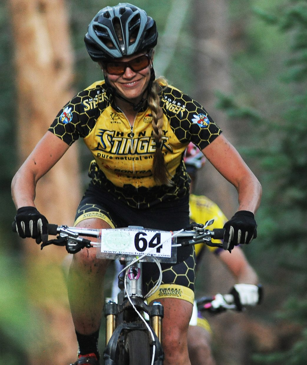 Hannah Williams smiles wide as he heads toward the finish of Wednesday night's Town Challenge mountain bike race. She lost the day, finishing just behind Linnea Dixson. But Williams won the season, claiming the top women's division championship for the second consecutive summer.