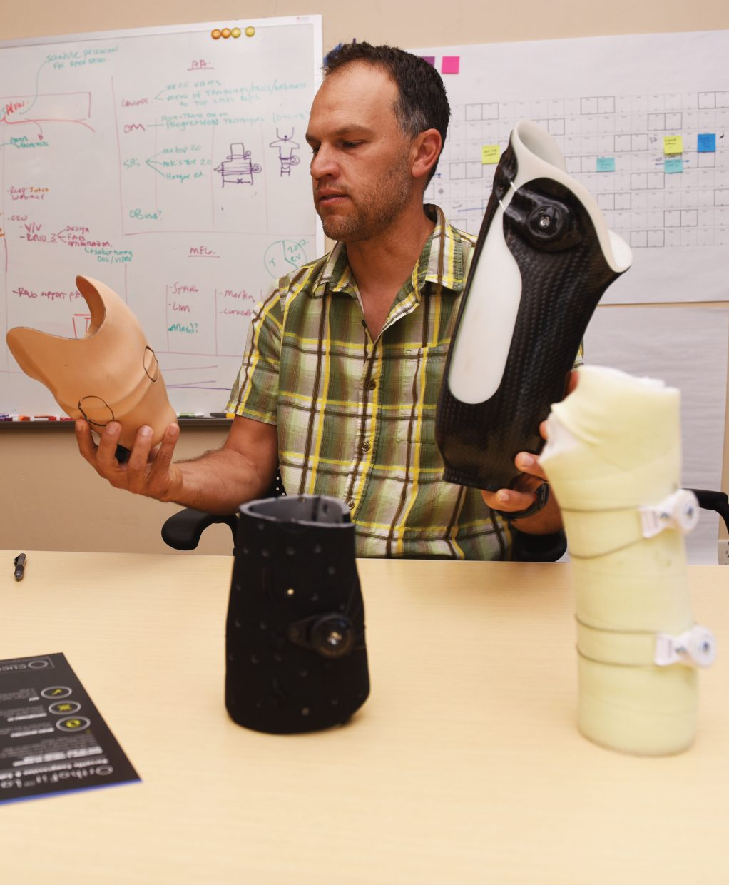 Click Medical CEO Jimmy Capra holds two examples of RevoFIT prosthetic sockets that utilize the Boa Closure System.
