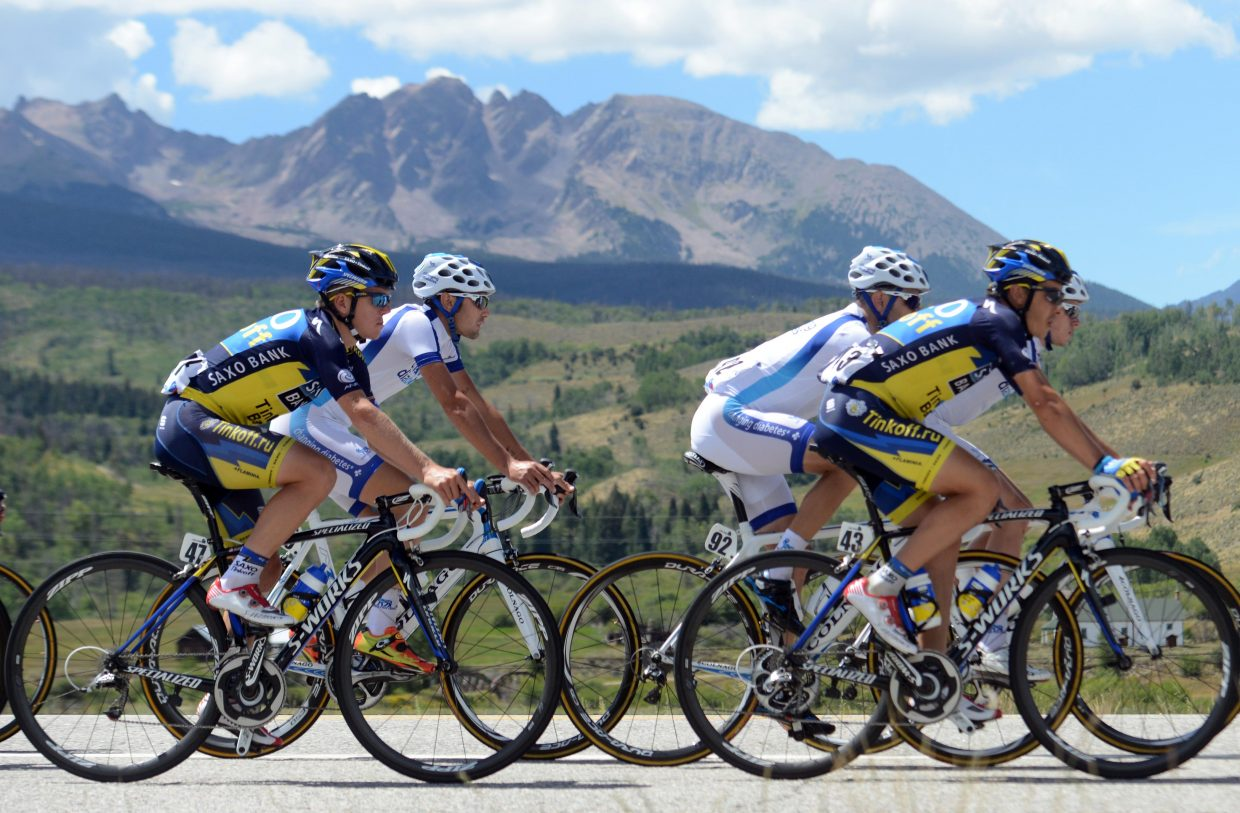 Cyclists ride toward Steamboat Springs during the 2013 USA Pro Challenge.
