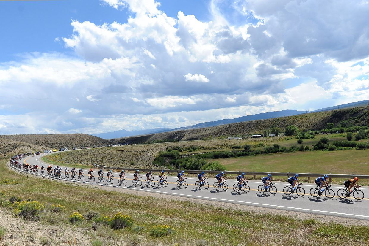 The peloton charges toward Steamboat Springs in 2013. When the riders in the big group decide it's time to catch up, they can do so in a hurry, stretching into a long, powerful line and riding hard to make up ground on any breakaway groups.