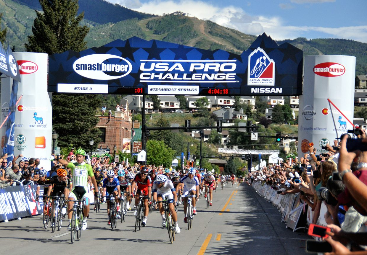 Peter Sagan, in green, celebrates his win after finishing at the front of a sprint finish during the 2013 USA Pro Challenge race in Steamboat Springs.