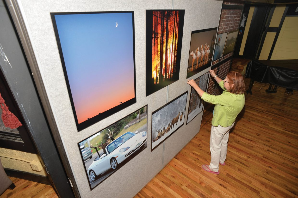 Longtime Steamboat Pilot & Today employee Deb Proper helps hang an art show celebrating 25 years of the Today at the Depot Art Center. Steamboat Today will host an opening reception and party from 5 to 8 p.m. Friday at the Depot.