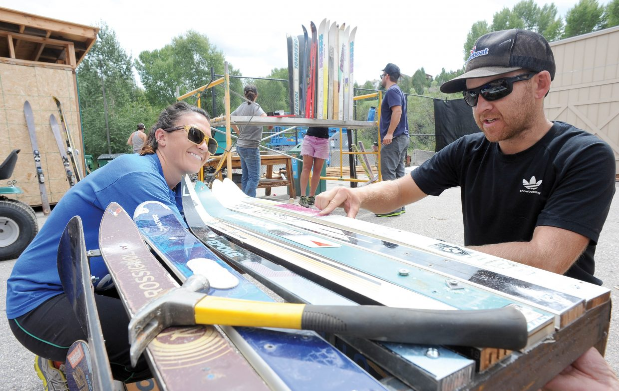 SmartWool employees Becca Diede, and Alex Pashley work together to create a recycling bin cover out of old skis. SmartWool employees teamed up with members of Alpine Initiatives to build 10 recycling bin covers that will be placed in parks around Steamboat Springs.
