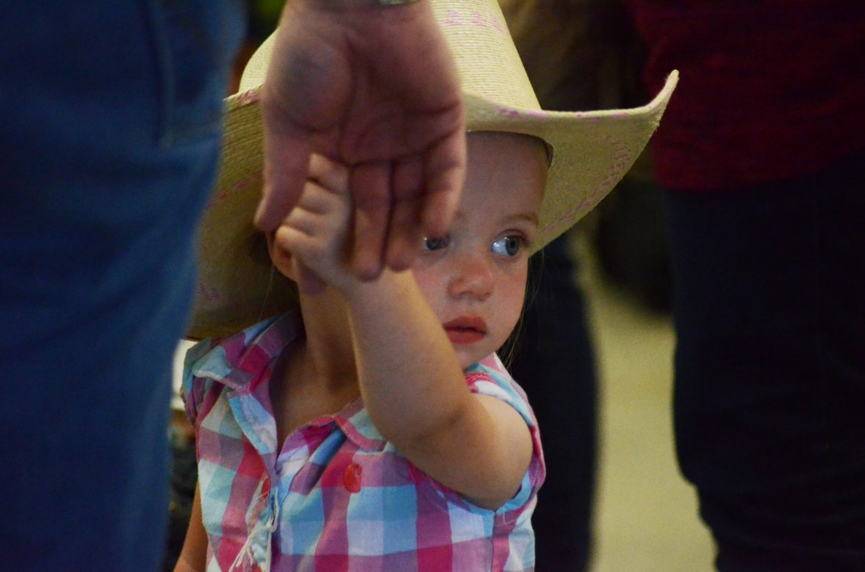 """Claire Corriveau, 23 months old, was awarded """"best western boots"""" for her pink John Deere footwear. She was also chosen as prettiest baby in the 18-month to 3-year-old category."""