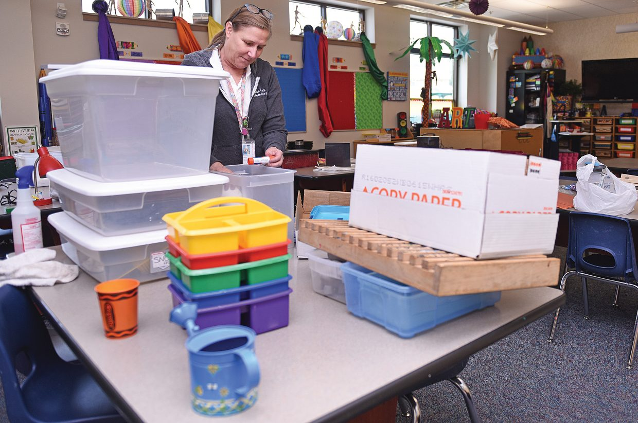 Soda Creek Elementary School teacher Ann Dixon unpacks boxes while setting up her classroom Aug. 22. The majority of students will return to class Aug. 23 as a new school years begins. Kindergartners will get an extra day of summer break before returning to class Aug. 24.