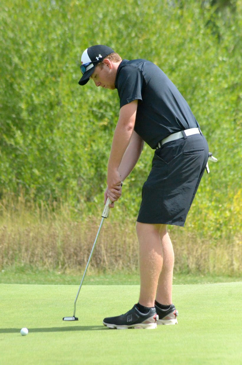 Steamboat Springs High School's Jacob Taulman taps it in on the ninth green Monday at Yampa Valley Golf Course in Craig. Taulman shot an 84 for the Sailors.